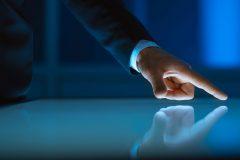 Finger pressing computer screen